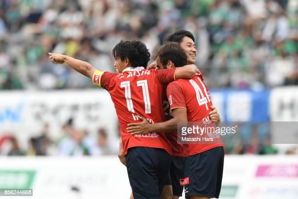 Players of Nagoya Grampus celebrate their third goal during the J.League J2 match between FC GIfu and Nagoya Grampus at Nagaragawa Stadium on October...
