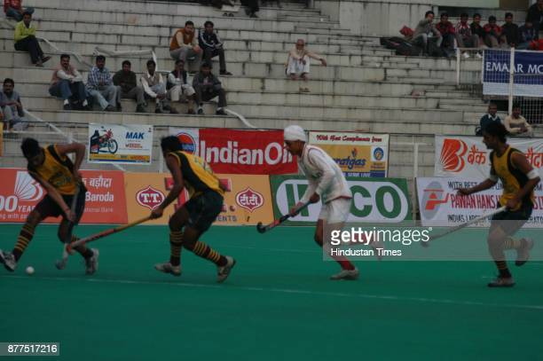 Players of NamdhariXI [White Jersey] and PNB [Yellow Jersey] in action during Lal Bahadur Shastri Hockey Tournament Final at Shivaji Stadium in New...