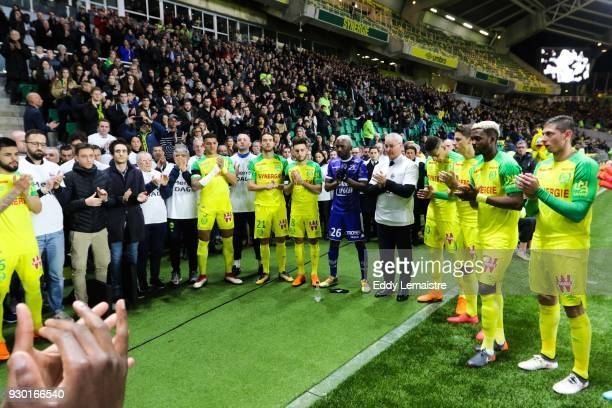 Players of Nantes and Claudio Ranieri Head coach of Nantes during the one minute of applause in memory of the kinesitherapeuthe of the team of Nantes...