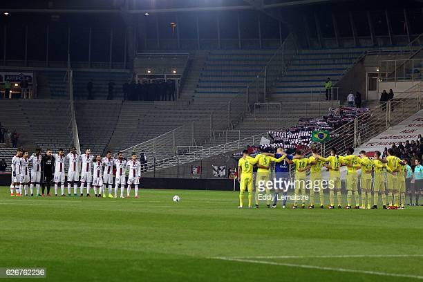 Players of Nantes and Lyon during a minute of silence in memory of the Brazilian football team Chapecoense who has crashed in a plane in Colombia...