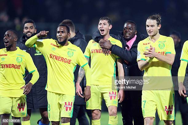 Players of Nantes celebrate with their fans at the end of the match the French Ligue 1 match between Angers and Nantes on December 16 2016 in Angers...