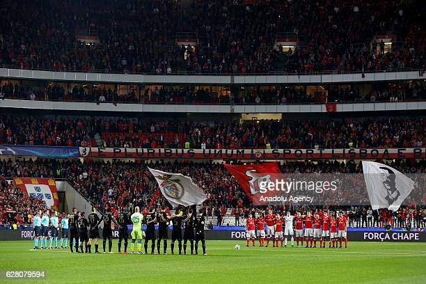 Players of Napoli and Benfica stand in silence in memory of AF Chapecoense ahead of the UEFA Champions League Group B football match between SL...