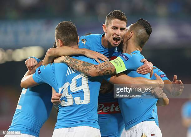 Players of Napoli celebrate during the UEFA Champions League match between SSC Napoli and Benfica at Stadio San Paolo on September 28 2016 in Naples