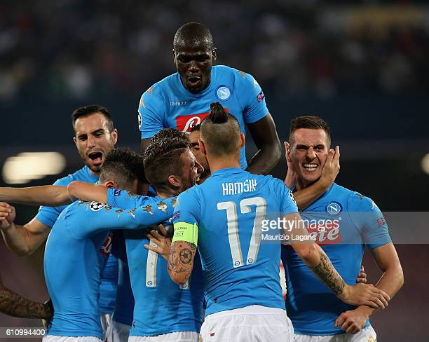 Players of Napoli celebrate the third goal during the UEFA Champions League match between SSC Napoli and Benfica at Stadio San Paolo on September 28...
