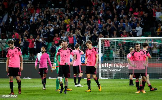 Players of national football team of Scotland look dejected after the FIFA 2018 World Cup Qualifier match between Slovenia and Scotland at stadium...