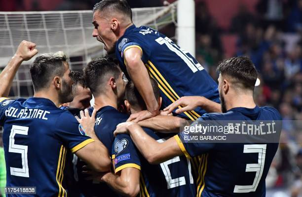 Players of national team of Bosnia and Herzegovina celebrate after scorring during the UEFA Euro 2020 Group J qualifier football match between...