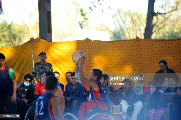 Players of Nepalese Wheelchair Basketball Team Men and India Wheelchair Basketball Team Men fights for the ball in Final Game of International...