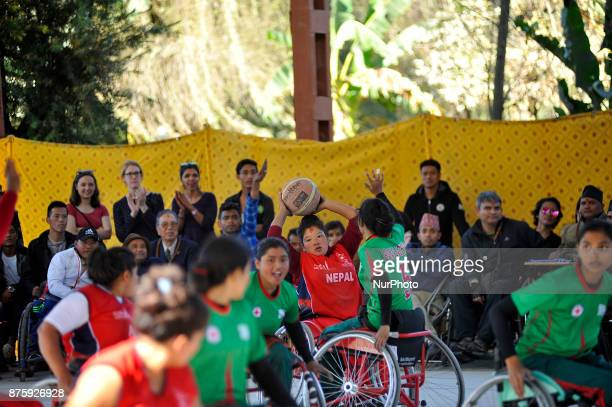 Players of Nepalese Wheelchair Basketball Team Woman and Bangladesh Wheelchair Basketball Team Woman fights for the ball in Final Game of...