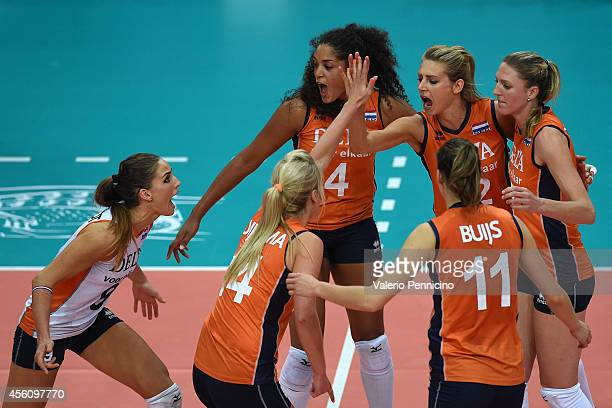 Players of Netherlands celebrate a point during the FIVB Women's World Championship pool C match between Netherlands and USA on September 25, 2014 in...