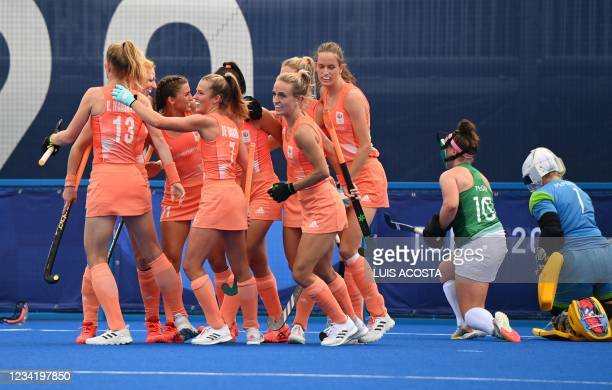 Players of Netherlands celebrate after scoring against Ireland during their women's pool A match of the Tokyo 2020 Olympic Games field hockey...