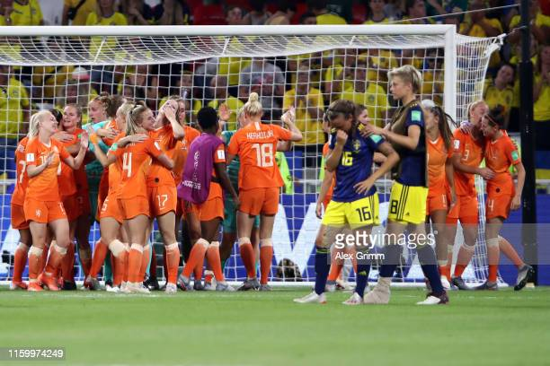 Players of Netherlands celebrate as Julia Zigiotti and Lina Hurtig of Sweden react after the 2019 FIFA Women's World Cup France Semi Final match...