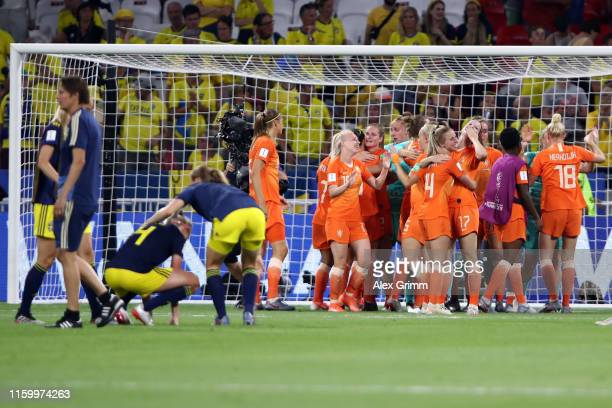 Players of Netherlands celebrate players of Sweden react after the 2019 FIFA Women's World Cup France Semi Final match between Netherlands and Sweden...