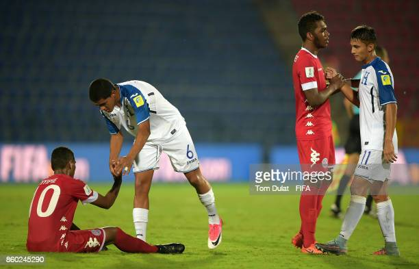 Players of New Caledonia Cyril Nyipe and Sidri Wadenges shake hands with players of Honduras Luis Palma and Kenneth Martinez after the FIFA U17 World...