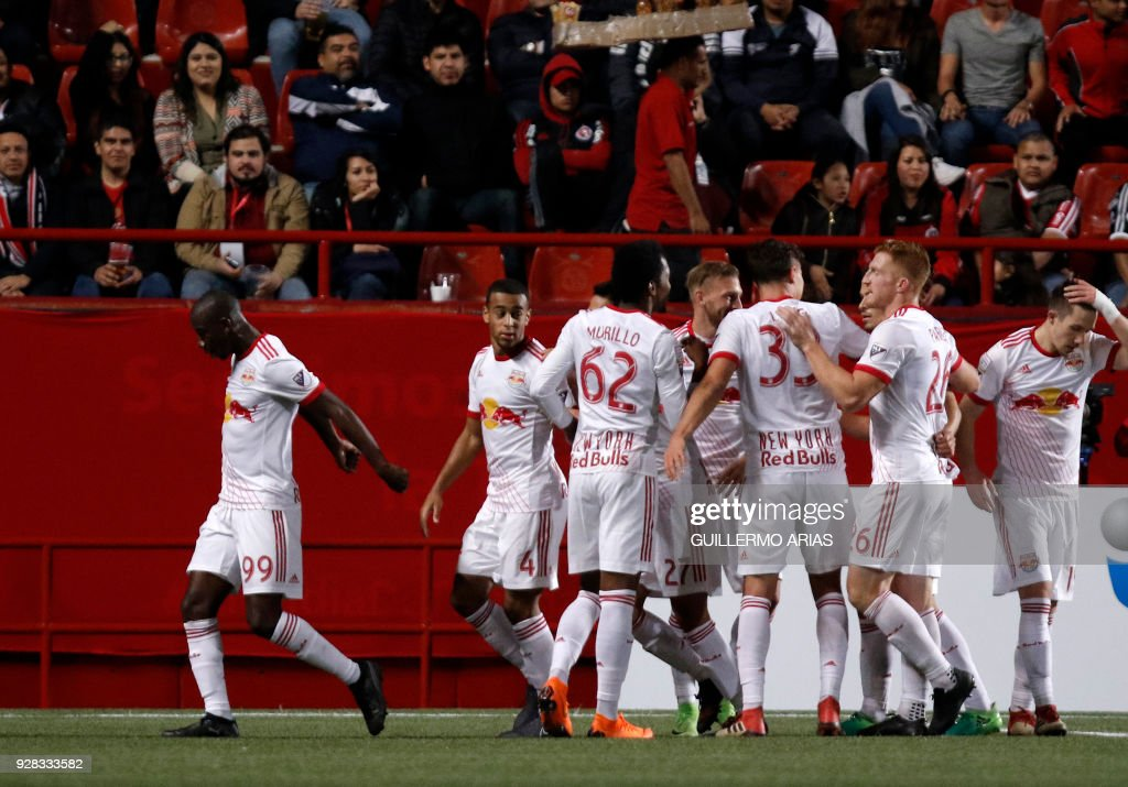 Players of New York from United States celebrate their second goal against Tijuana from Mexico during the first leg of the CONCACAF Champions League quarterfinals match at Caliente Stadium in Tijuana, Mexico on March 6, 2018. /