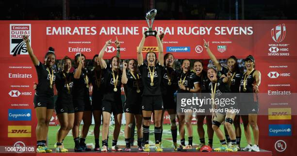 Players of New Zealand celebrate with the trophy after winning the HSBC World Rugby Women's Sevens Series 2019 Dubai Cup Final between New Zealand...