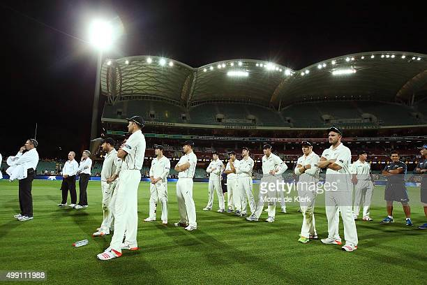 Players of New Zealand look on after the end of the match on day three of the Third Test match between Australia and New Zealand at Adelaide Oval on...