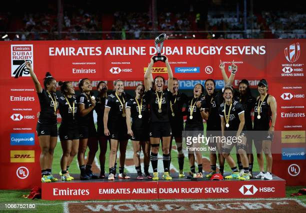 Players of New Zealand Women's Rugby Sevens team celebrate with the trophy after winning the HSBC World Rugby Women's Sevens Series Cup Final match...