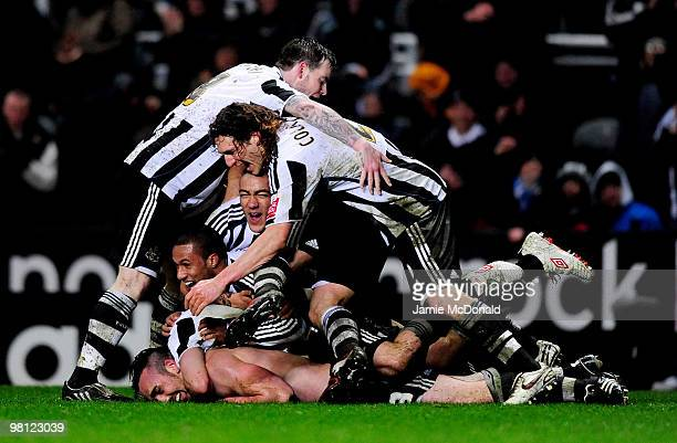 Players of Newcastle celebrate the goal of Jose Enrique of Newcastle United during the Coca-Cola Championship match between Newcastle United and...