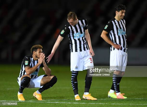 Players of Newcastle United look dejected during the penalty shoot out during the Carabao Cup fourth round match between Newport County and Newcastle...