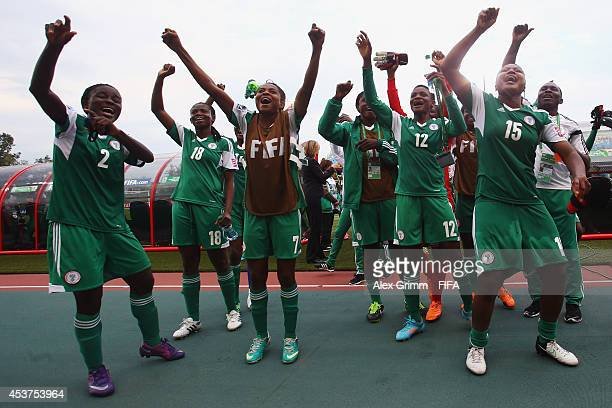 Players of Nigeria celebrate after the FIFA U20 Women's World Cup Canada 2014 Quarter Final match between Nigeria and New Zealand at Moncton Stadium...