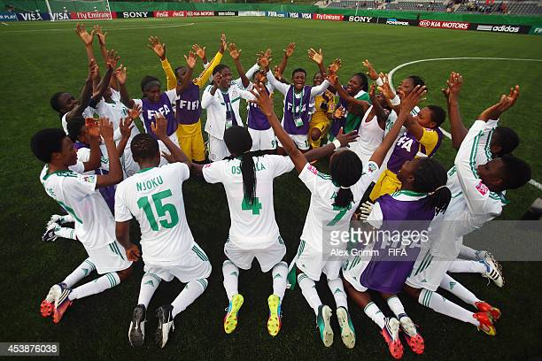 Players of Nigeria celebrate after the FIFA U20 Women's World Cup Canada 2014 Semi Final match between Korea DPR and Nigeria at Moncton Stadium on...
