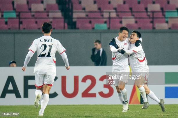 Players of North Korea celebrate a point during the AFC U23 Championship Group B match between Palestine and North Korea at Jiangyin Stadium on...