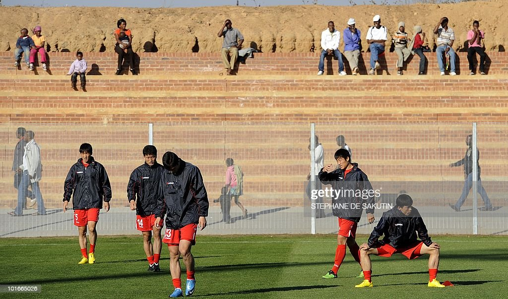 Players of North Korea's national football team warm up at Makhulong stadium prior to their international friendly football match against Nigeria on June 6, 2010 in Tembisa . The 2010 FIFA World Cup football championship is due to take place in South Africa from June 11 to July 11 of 2010.