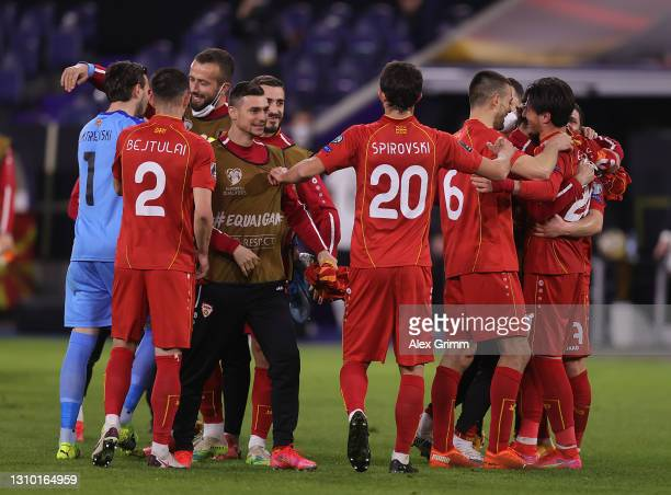 Players of North Macedonia celebrate following their side's victory in the FIFA World Cup 2022 Qatar qualifying match between Germany and North...