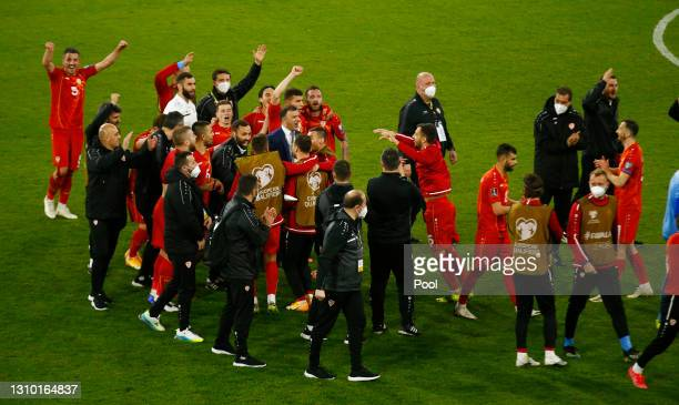 Players of North Macedonia celebrate following victory during the FIFA World Cup 2022 Qatar qualifying match between Germany and North Macedonia at...
