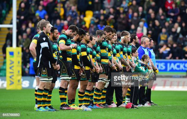 Players of Northampton Saints line up for a minutes silence of respect for the passing of former player Dan Vickerman during the Aviva Premiership...