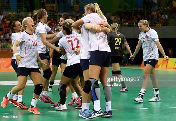 Players of Norway celebrate after winning the Womens Quarterfinal match between Sweden and Norway on Day 11 of the Rio 2016 Olympic Games at the...