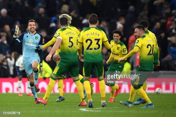 Players of Norwich City celebrate after winning the penalty shootout during the FA Cup Fifth Round match between Tottenham Hotspur and Norwich City...