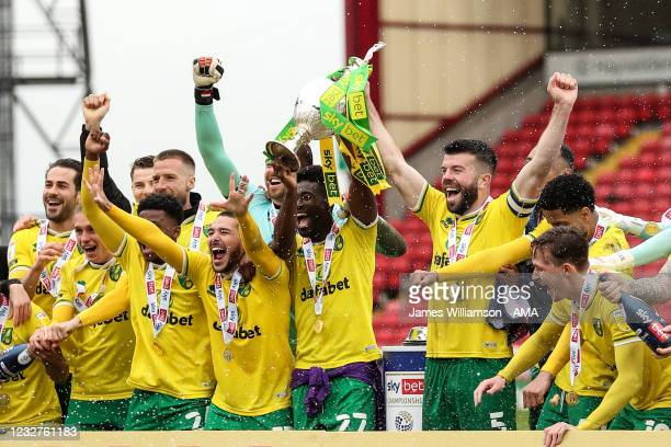 Players of Norwich City celebrate as Grant Hanley of Norwich City lifts the Sky Bet Championship trophy during the Sky Bet Championship match between...