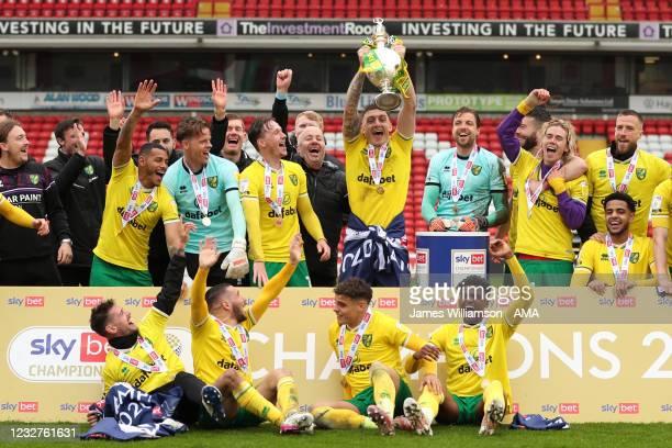 Players of Norwich City celebrate winning the Sky Bet Championship as Tim Krul of Norwich City lifts the trophy during the Sky Bet Championship match...