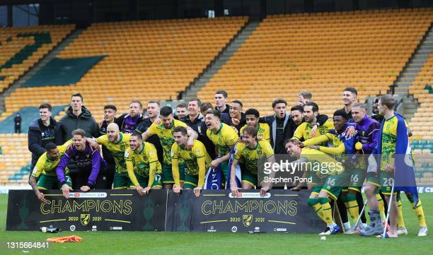 Players of Norwich City celebrate winning the Sky Bet Championship after the Sky Bet Championship match between Norwich City and Reading at Carrow...