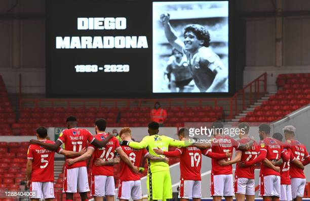 Players of Nottingham Forest take part in a minute of silence for Diego Maradona prior to the Sky Bet Championship match between Nottingham Forest...