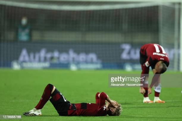 Players of Nürnberg react after the Second Bundesliga match between 1. FC Nürnberg and SV Darmstadt 98 at Max-Morlock-Stadion on October 05, 2020 in...