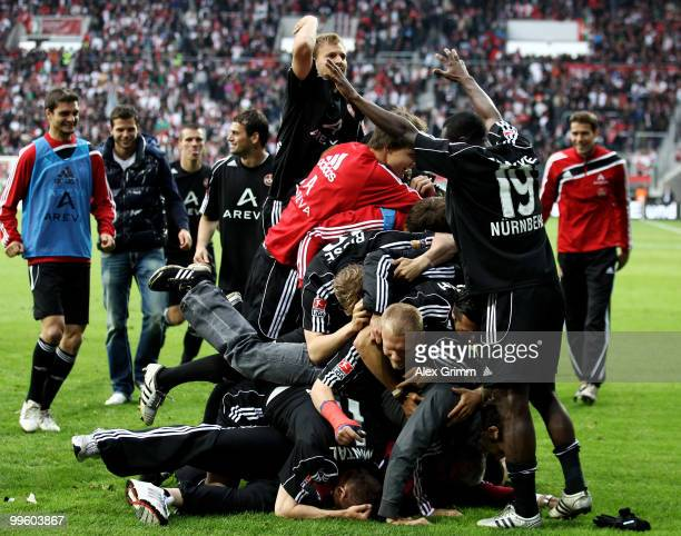 Players of Nuernberg celebrate after the Bundesliga play off leg two match between FC Augsburg and 1. FC Nuernberg at the Impuls Arena on May 16,...