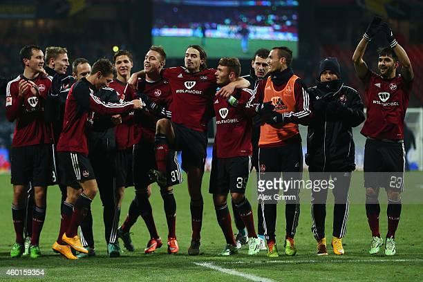Players of Nuernberg celebrate after the Second Bundesliga match between 1. FC Nuernberg and TSV 1860 Muenchen at Grundig-Stadion on December 8, 2014...