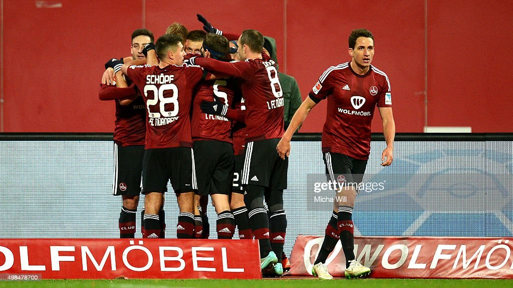 Players of Nuernberg celebrate their teams second goal scored by Guido Burgstaller of Nuernberg during the Second Bundesliga match between 1. FC Nuernberg and Eintracht Braunschweig at Grundig-Stadion on November 23, 2015 in Nuremberg, Germany.