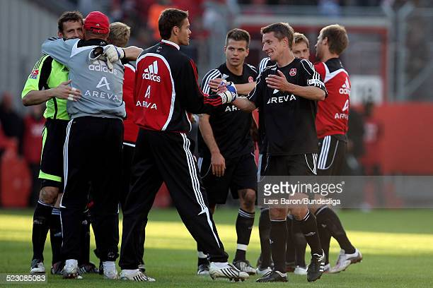 Players of Nuernberg celebrates after winning the Bundesliga Play Off match between FC Energie Cottbus and 1.FC Nuernberg at the Stadion der...
