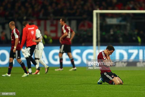 Players of Nuernberg react after the Bundesliga Playoff Leg 2 between 1 FC Nuernberg and Eintracht Frankfurt at GrundigStadion on May 23 2016 in...