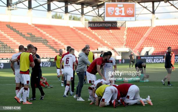 Players of Nuremberg celebrate after the 2 Bundesliga playoff second leg match between FC Ingolstadt and 1 FC Nürnberg at Audi Sportpark on July 11...