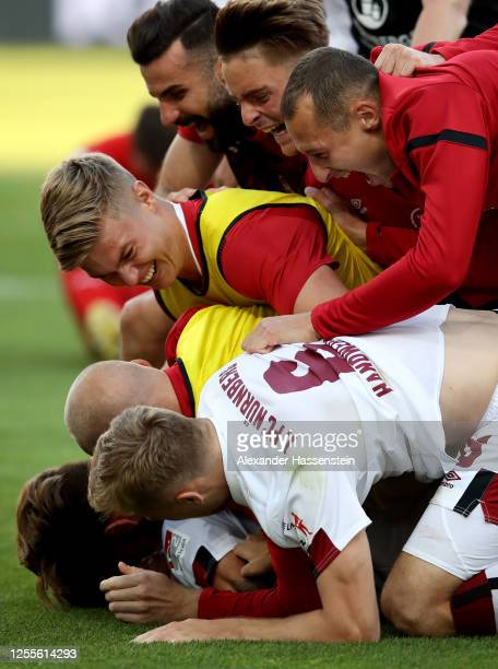 Players of Nuremberg celebrate after the 2. Bundesliga playoff second leg match between FC Ingolstadt and 1. FC Nürnberg at Audi Sportpark on July...