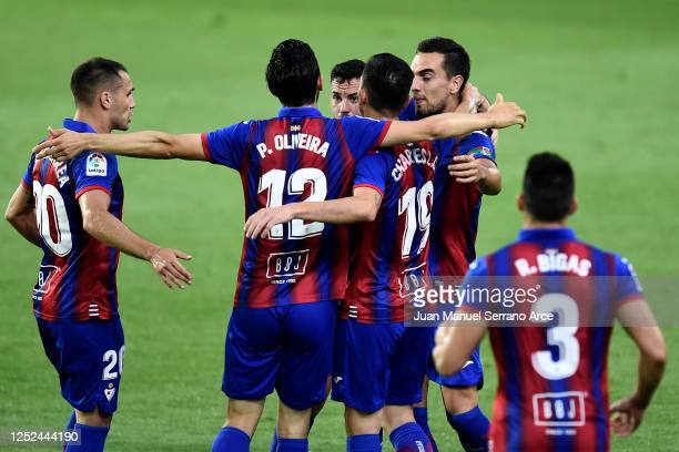 Players of of SD Eibar celebrate the first goal of the game, an own goal scored by Geoffrey Kondogbia of Valencia CF during the Liga match between SD...