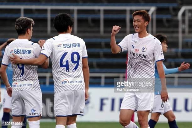 Players of Oita Trinita celebrate 2-1 victory at the end of during the J.League Meiji Yasuda J1 match between Yokohama FC and Oita Trinita at the NHK...