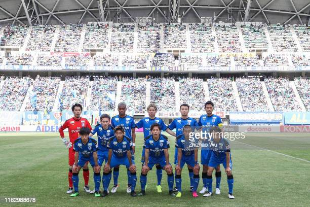 Players of Oita Trinita line up for team photos prior to the J.League J1 match between Oita Trinita and Sagan Tosu at Showa Denko Dome Oita on May...
