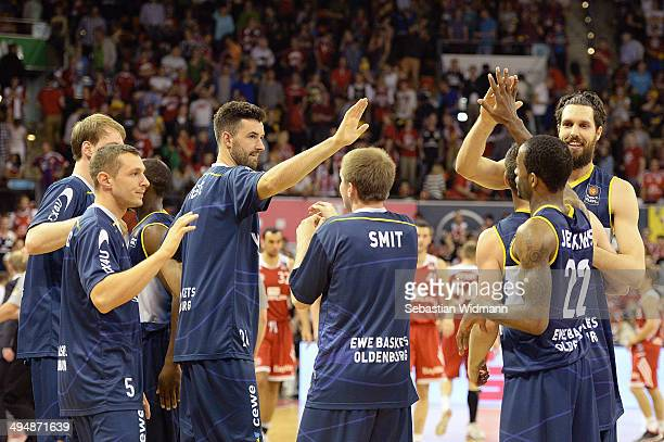 Players of Oldenburg celebrate after winning game three of the 2014 Beko BBL Playoffs SemiFinal between FC Bayern Muenchen and EWE Baskets Oldenburg...