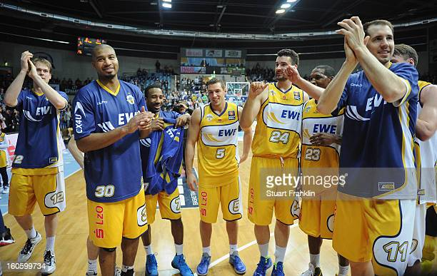 Players of Oldenburg celebrate at the end of the BBL game between EWE Baskets Oldenburg and Alba Berlin at the EWE arena on February 3 2013 in...