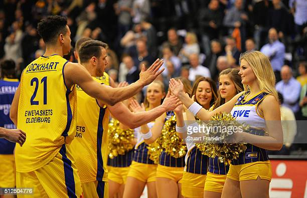 Players of Oldenburg celebrate with cheer leaders during the Bundesliga basketball match between EWE Baskets Oldenburg and Phoenix Hagen at Large EWE...